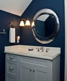 Vintage Wall Sconce Adds Elegance to Bold, Blue Bathroom #bathroom #lighting