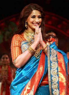 Sonali Bendre, looks vibrant and at Shatika we are proud of the Maharashtrian beauty, who looks stunning in the blue and red heavy silk saree resplendent with heavy jewellery. She has been very active on television and we admire her for her focus on her family life.