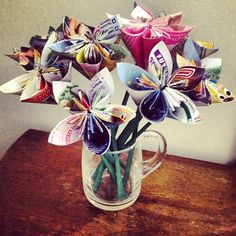 DIY: Repurposed Walt Disney World maps into paper flowers.   Katie from K-Town