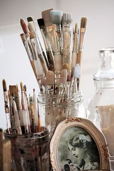 This is precisely how my paintbrushes are stored. I keep a pic of my grandmother next to them who was an artist, she made a good living doing oil portraits in her time. I keep a bottle of oil for cleaning, and A tin cup to dump the oil in. :D Wonderful