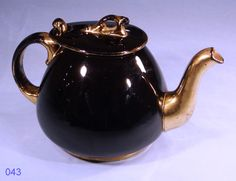 Black and Gold Vintage Teapot made in England  Stylish Vintage Tea Pot,  made in England. In a high gloss black with a gold spout and gold trim.