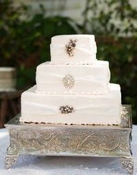 White wedding cake with brooches