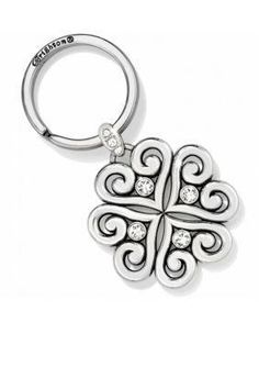 Brighton Alcazar Love Key Fob. Perfectly Brighton in every way, this silver-plated key fob is dotted with Swarovski crystals and swirly filigree hearts. It makes a graceful gift!