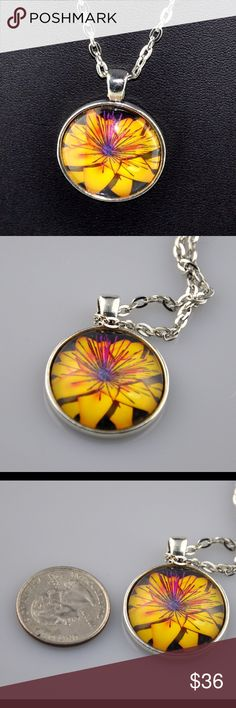 "Cheery Yellow Flower Handmade 24"" Pendant Yellow is just a bright and cheery color and this floral pendant is the perfect way to add a touch of sunshine to your outfit. Handmade 1"" round pendant uses a high quality photo image, sealed behind glass and mounted in an antique silver tone tray. Paired with a matching 24"" chain necklace. Hand assembled so small air bubbles may be present. Water resistant but not waterproof. Smoke free pet friendly home. YELLOWFLOWER Jennies Jewelry Chest Jewelry…"
