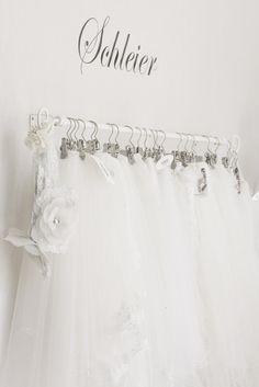 clips for hanging veils Bridal Boutique Interior, Boutique Interior Design, Boutique Decor, Boutique Ideas, Rental Wedding Dresses, Wedding Dress Boutiques, Bridal Consignment, Elegance Boutique, Fashion Showroom
