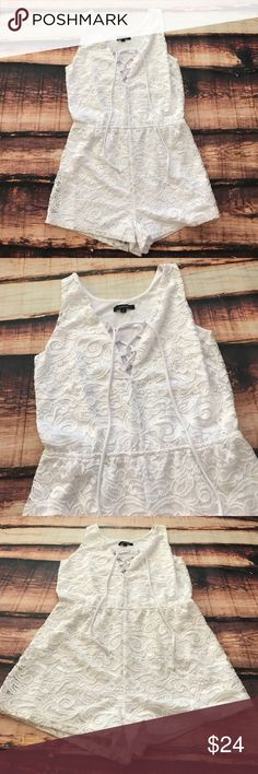 << Lace Front Lace Up Strappy White Romper >> Such a cute and easy outfit! Adorable for a beach or lake day!  Or dress it up with some heels and gladiator sandals and you will be ready for a hot night out on the town. Fully lined. Elastic waist. Fits true to size. Measures 17.5 inches across the bust unstretched. It does have stretch to it. Made of 90% nylon 10% Spandex. Lining is 100% Polyester Boutique Pants Jumpsuits & Rompers
