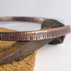 For the man on your list: Hammered Heavy Copper Wire Bangle Bracelet by LostMarblesJewelry, $55.00