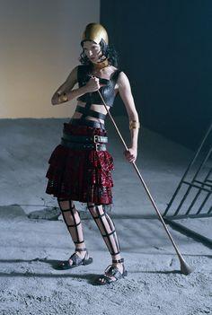 "Vogue Italia, March 2014 ""Like a Warrior"" Photographer: Tim Walker Styling: Jacob K Hair: Malcolm Edwards Makeup: Val Garland Nails: Anatole Rainey Model: Mariacarla Boscono"