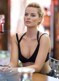 'I ate salad and went to the gym': in Focus, Margot strips down to her bikini once again a...