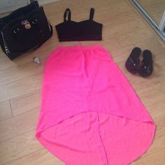 Hot pink asymmetrical skirt Skirt is short in the front and long in the back. Skirt is sheer with a solid attached mini skirt underneath. Size says Medium 7-9 No Boundaries Dresses Asymmetrical