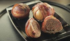 Get the recipe for Onion Bombs, onions stuffed with ground beef and smoke-roasted on the grill. From Episode 204 of Steven Raichlen's Project Smoke.