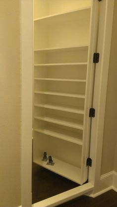 Secret room door with built in shelves