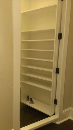 Secret room door with built in shelves