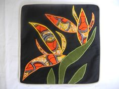 19″ square cover features vivid African kitenge Bird of Paradise tropical flower set against a black background with cream piping. All 100% cotton. Back is jungle green East African tie dye.