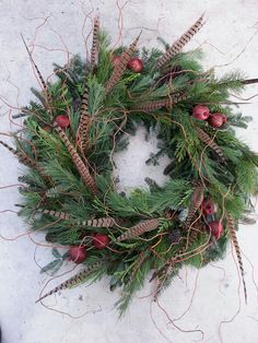 Custom Christmas Wreath - Pheasant Feathers, Pomegranate, mixed Cedar, and Corkscrew Willow.