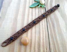 This gorgeous mens micro macrame bracelet features Matt Black Onyx beads, set with brown wax thread and for the closer a coconut bead. The wax