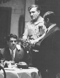 Joe Lombardi works with Al Lettieri (Sollozzo) and Al Pacino to guarantee that the scene - and the gun - goes off without a hitch.