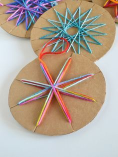 DIY string ornament; I would paint the cardboard gold or silver first then use multicolored yarn or string