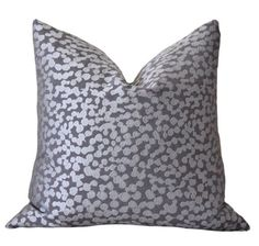 This is a Beautiful Designer Pillow Cover that was designed to be both graphic and playful. The coloring is more of steel grey mixed with a tint of