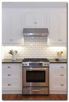 Ceramic subway tile kitchen backsplash white kitchen cabinets with white subway tile beveled subway tile kitchen Kitchen Cabinets Decor, Cabinet Decor, Kitchen Redo, Kitchen Tiles, New Kitchen, Kitchen White, Cabinet Ideas, Country Kitchen, Updated Kitchen