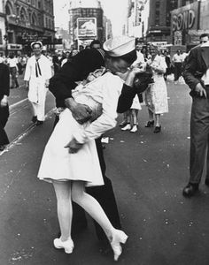 """""""The Kissing Sailor""""  V-J Day in Times Square taken by Alfred Eisenstaedt for Life Magazine (1945) page 27  Taken on August 14, 1945 of George Mendonsa (22 years old) Navy quartermaster and Greta Zimmerman (21 year old) dental assistant"""