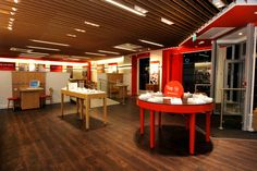 Vodafone store in Birmingham, UK fitted with Polyflor's SimpLay loose lay wood effect flooring tiles in Rich Walnut