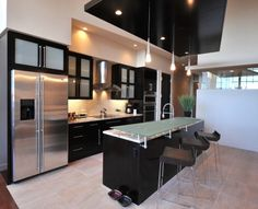 Suspended shape ceiling to extend the kitchen into the living area