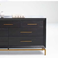 Crafted of solid acacia wood and equipped with seven roomy drawers, our Alexa Dresser features a bold finish that shows off the rich, textured grain. Gold Dresser, 5 Drawer Dresser, Modern Dresser, West Elm, Home Decor Furniture, Modern Furniture, Office Furniture, Black And Gold Bathroom, Black Dressers
