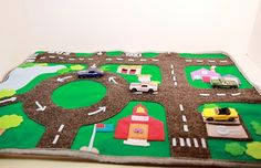 Portable Car Activity Mat Set. If you're not a sewing/fabric person, easy to create using markers and construction paper. Drive cars along the roads on top of baking sheets.
