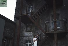 Making their escape - on the fire stairs at the striking Millhouse, Slane. A real wedding by Couple Photography