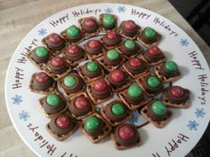"""3 ingredients: Snyder's """"Snaps"""" pretzels, Hershey Kisses and Peanut Butter M&M;'s. - Place Hershey Kisses on Pretzels and bake at 275 degrees for 3 minutes. Top with M&M;'s and you're DONE. It's that easy!"""