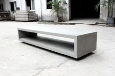 Modern concrete tv bench by Lyon Beton at Rowat & Gray in London , available nationwide contact us on 02075374139 / info@rowatandgray.com for more information