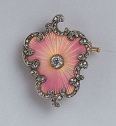 Fabergé -- Guilloche Enameled & Gem-set Gold Brooch -- Circa 1896-1903 -- Workmaster: Michael Perchin (St. Petersburg) -- Centred by an old brilliant cut diamond & enameled translucent pink over a sunburst guillochage, edged with rose diamond rocaille. Via Wartski.