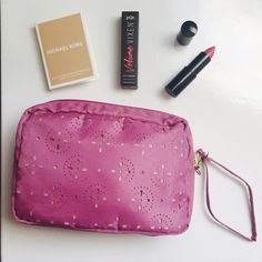 Pink lace cutout makeup bag or clutch/wristlet Never been used! Small to medium sized. Pretty lace cutout details makes it elegant. <<All cosmetic bag purchases or clutches will come with a FREE sample inside>> Uber Bags Cosmetic Bags & Cases