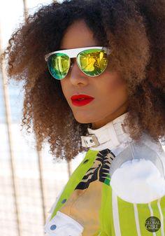 The Global Girl Daily Style: Ndoema rocks bold yellow and green mirrored sunglasses.