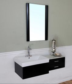 dark floating vanity with square white porcelain sink and matching mirror... Hottest Space-Saving Bathroom Trends for 2015 from The Bathroom Bliss Blog