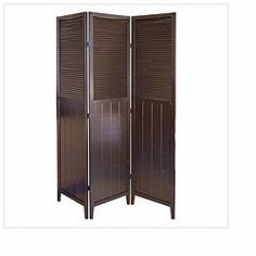 This Shutter decorative screen features an espresso finish and three hinged panels. This cottage-style screen makes the perfect room divider for any style.  http://www.overstock.com/Home-Garden/Shutter-Door-Espresso-3-panel-Room-Divider/5127301/product.html?CID=214117 $169.99