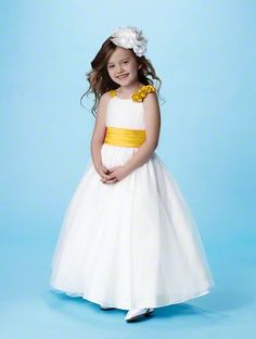 Even your littlest bridal party members can have a hint of yellow. #AlfredAngelo has several flower girl dresses available in 50 Dream in Color shades. Style number shown: #6654 color: #canary #yellow. Yellow flower girl dress
