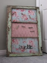 "Window repuposed into a ""bulletin board"" by adding chicken wire to each pane and then three fabric boards......"
