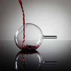 rEvolution Glass  By Martin Jakobsen    This beautiful and innovative red wine glass puts a twist on your cocktail ritual with its unusual design. It's easy to pour and drink from this handmade piece.
