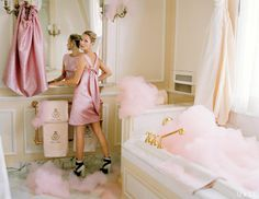 Kate Moss, in the bathroom of the Coco Chanel Suite, wears a petal-like cocktail dress and cape, inspired by a 1960 design, from a pink-and-silver cloque lamé created by Cristóbal Balenciaga. Photographed by Tim Walker.