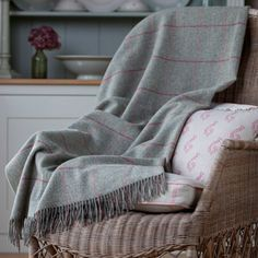 Our beautiful grey Shetland wool blanket with a hint of colour, perfect for those cold winter evenings next to a lovely log fire.