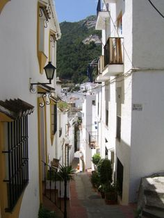 Some of the streets in Ojen in Southern Spain are extremely narrow and driving is impossible. Park outside, wonder round and sit in the square soaking up the culture of Andalusia.