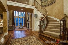 Elegant, curving staircase. Real Estate Photography | Shoot2Sell.net