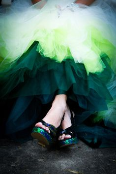 I actually like this idea of colored ombre tulle underneath the dress. I would do blue though. Green is kind of wild and yuck.