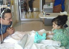He's her hero: Angelo Mondragon is reunited with Sitali Hernandez at her hospital bed on Monday afternoon