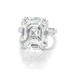 Platinum and Diamond Ring Centering one cut-cornered rectangular step-cut diamond approximately cts., flanked by 2 tapered baguette diamonds. Emerald Cut Diamond Engagement Ring, Platinum Diamond Rings, Emerald Cut Diamonds, Diamond Wedding Rings, Diamond Cuts, Engagement Ring Photos, Classic Engagement Rings, Fashion Rings, Fine Jewelry