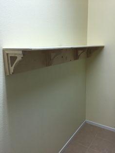 Laundry room shelf.