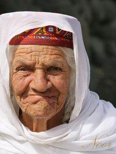 An old ethnic Wakhi lady, above 85, smiles for the camera during a wedding in her native village deep in the Karakuram mountain range, in Upper Hunza Valley.