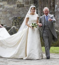 Prince Charles leads bride Alexandra Knatchbull, the daughter of his close friendNorton Knatchbull, who holds the title of Lord Brabourne, into Romsey Abbey in Hampshire